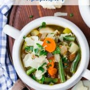"""Soup in a small white crock, text overlay reads """"easy and delicious vegetable soup, rachelcooks.com"""""""