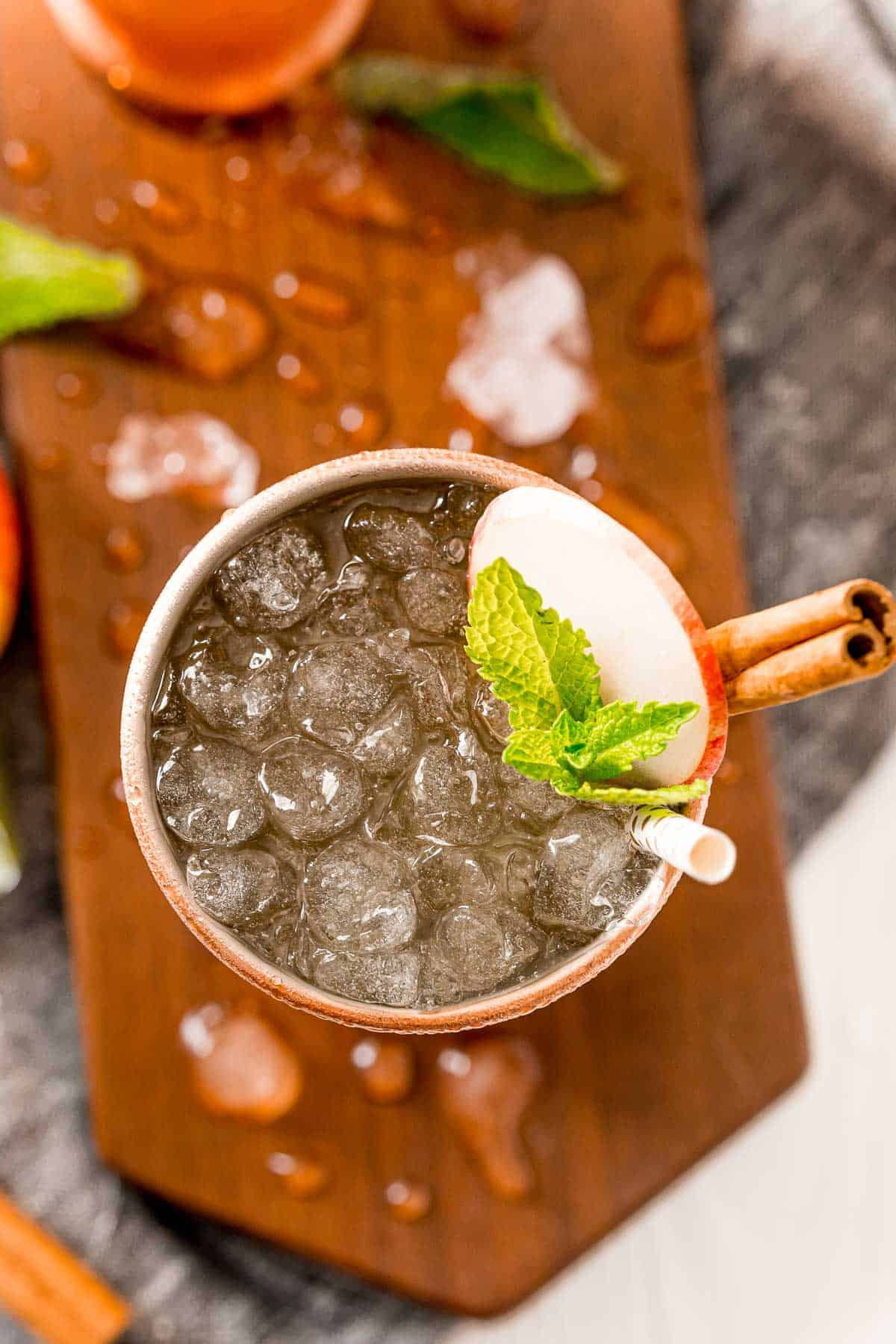 Overhead view of an apple cider mule served in a copper cup.