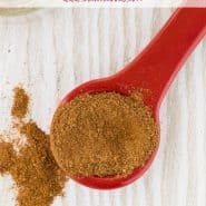"""Overhead view of spice mix on a read measuring spoon, text overlay reads """"easy homemade apple pie spice, rachelcooks.com"""""""