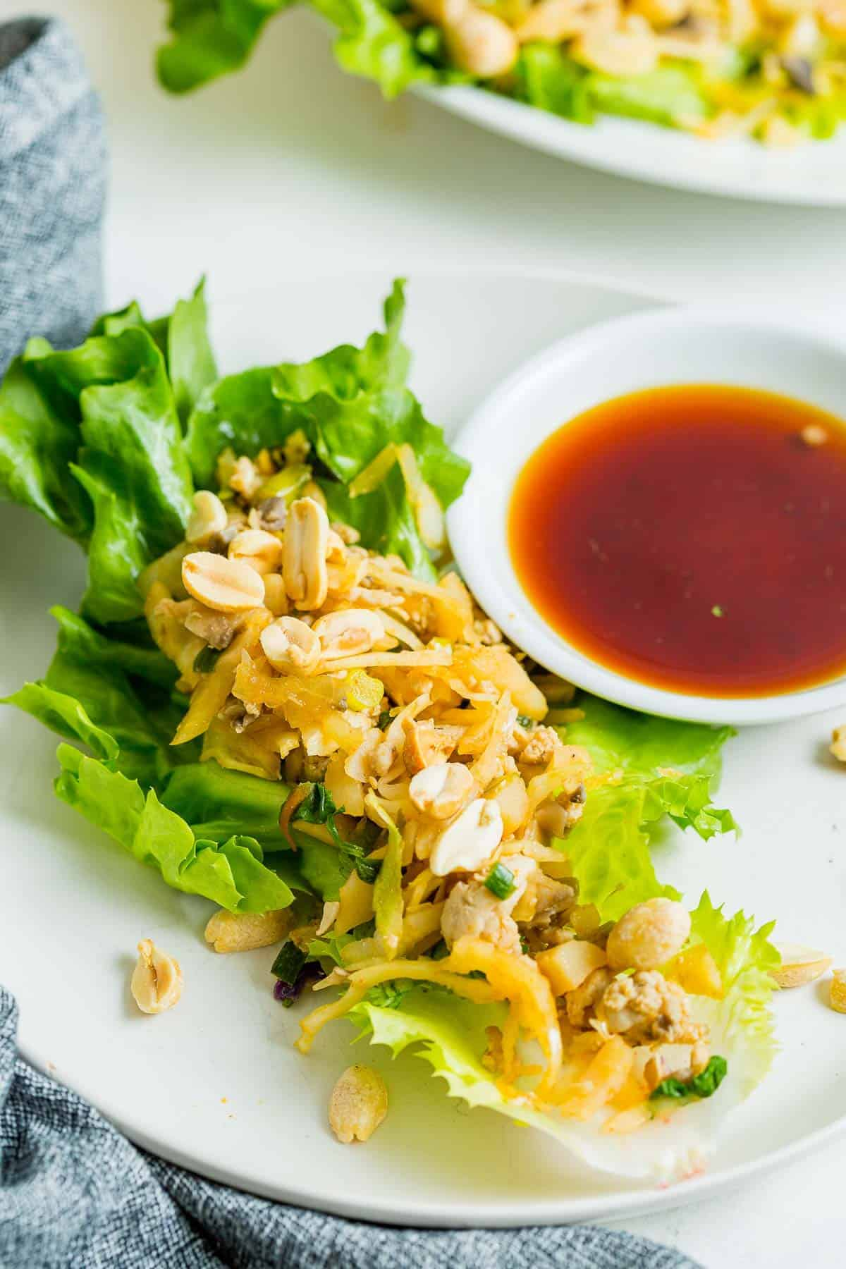 Chicken lettuce wrap with dipping sauce.
