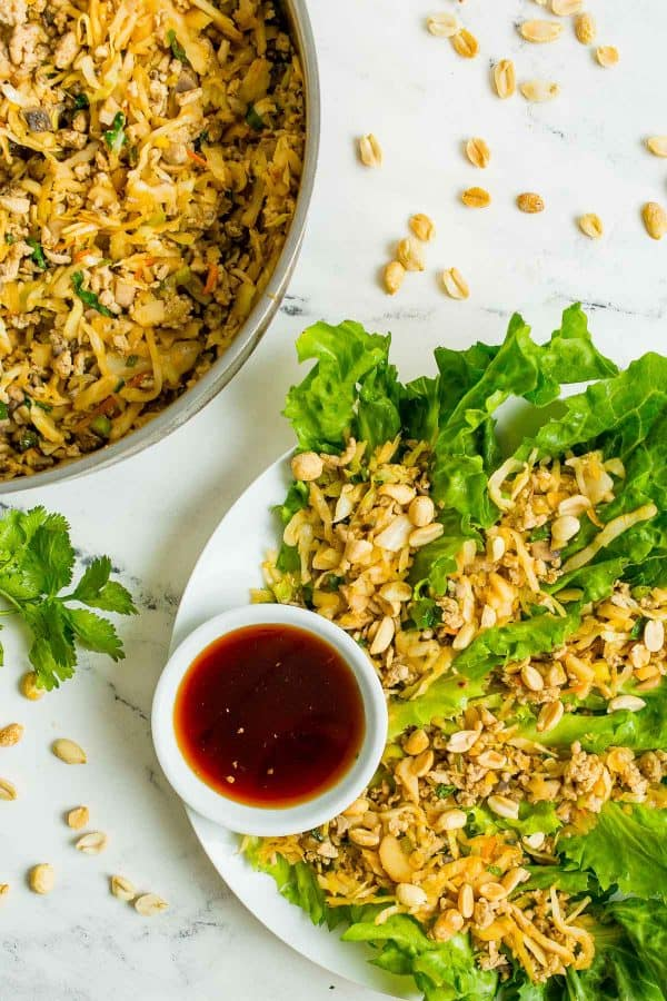 Chicken lettuce wraps on a plate and in a pan.