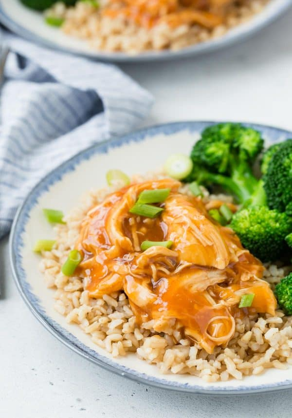 Honey sriracha chicken served over rice with a side of broccoli.