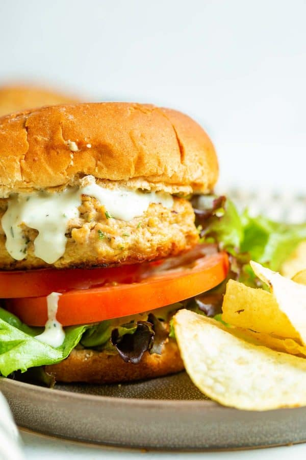 Turkey burger with all the fixings, on a plate with chips.