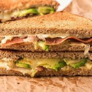 Bacon and avocado inside a grilled cheese sandwich.