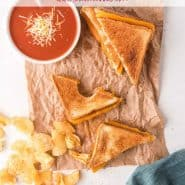 """Overhead view of lunch with grilled cheese. Text overlay reads """"air fryer grilled cheese with three unique recipes)"""