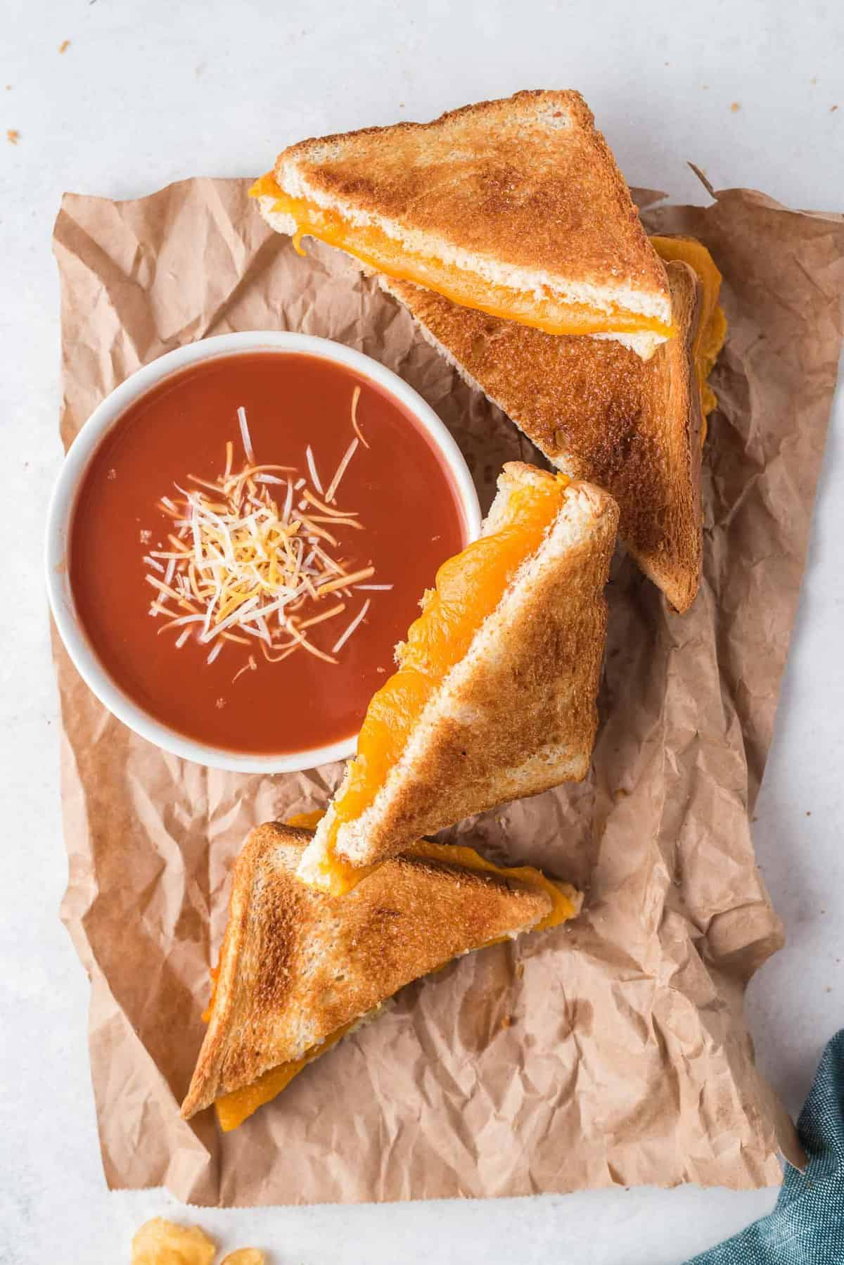 Grilled cheese sandwich halves, and tomato soup