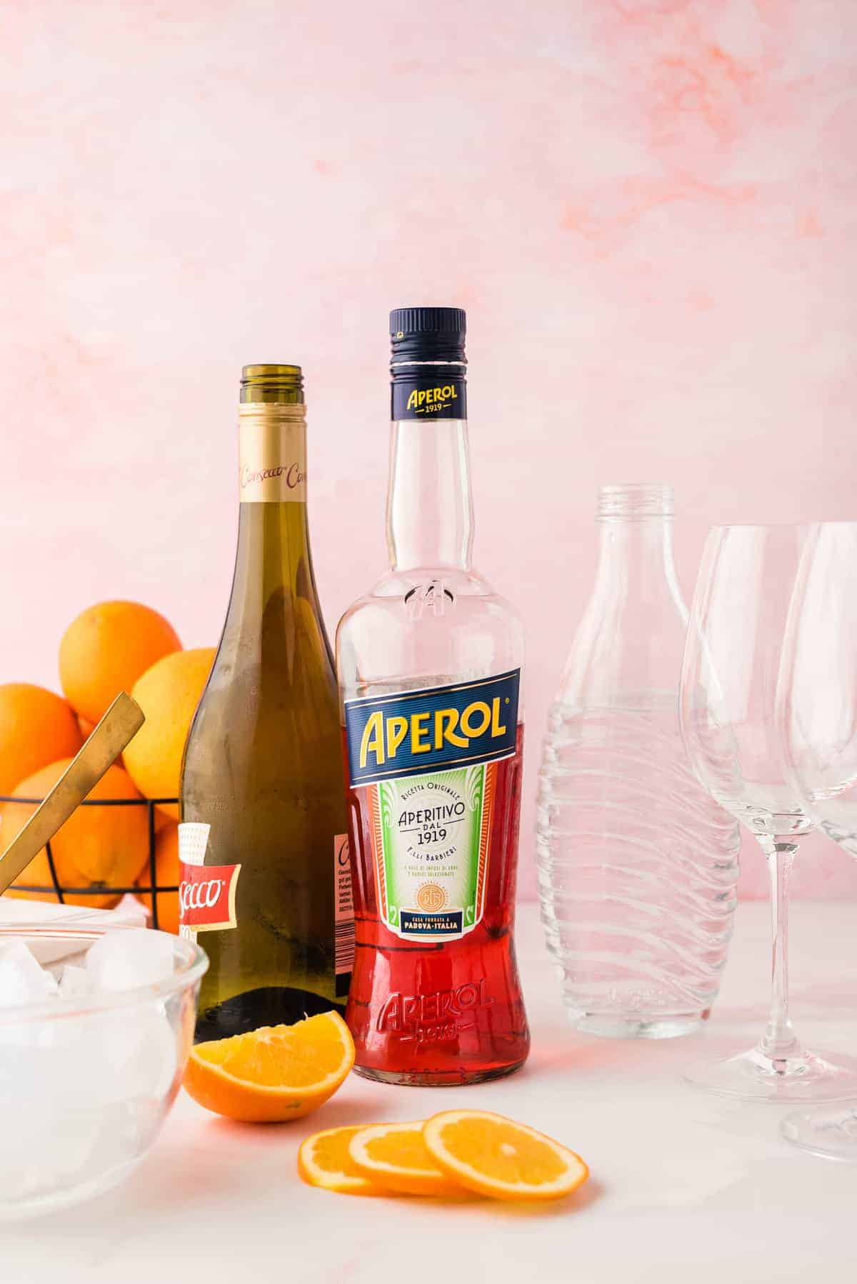 Ingredients needed for recipe: aperol, prosecco, and soda.
