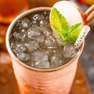 Apple cider mule in a copper cup.