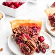 "Pie slice on a white plate, text overlay reads ""pecan cranberry pie, rachelcooks.com"""