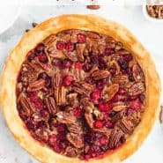 "Overhead view of pie, text overlay reads ""pecan cranberry pie, rachelcooks.com"""