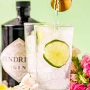 A gin and tonic being made. Text overlay present with recipe name.