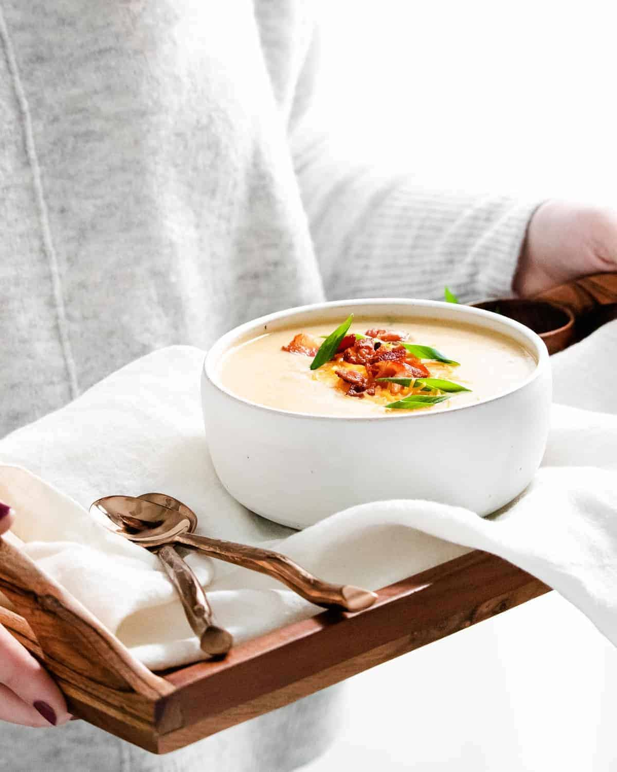 Soup on a tray with spoons.