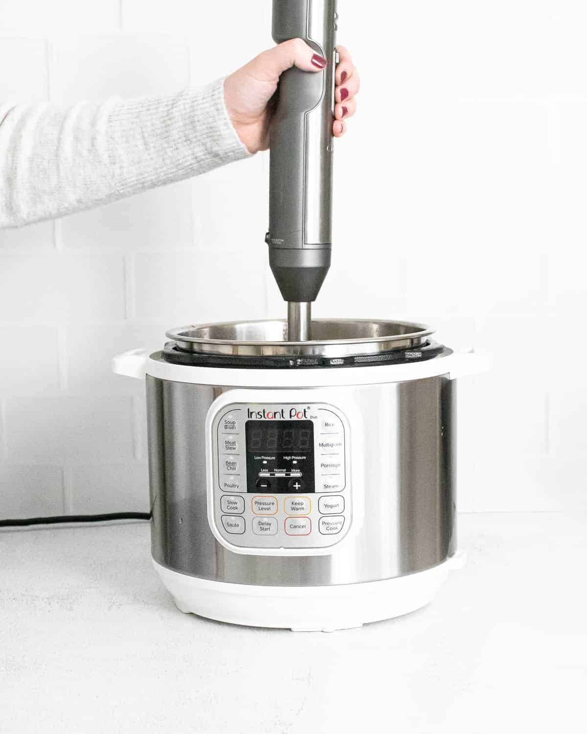 Soup in an Instant Pot being pureed.