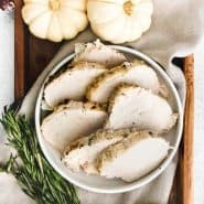 "Sliced turkey, with a text overlay that reads ""instant pot turkey breast - from frozen!"""