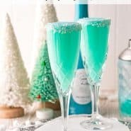 """Two bright blue drinks with coconut rims, text overlay reads """"jack frost mimosas, rachelcooks.com"""""""