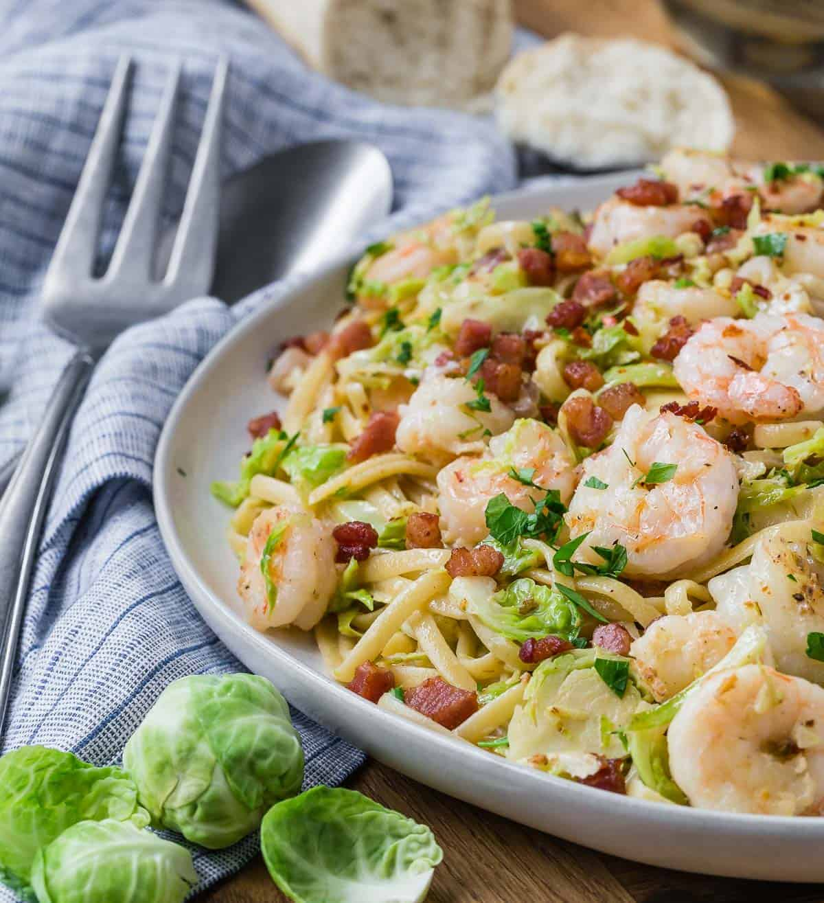 Large platter of pasta, shrimp, brussels, pancetta, and more.