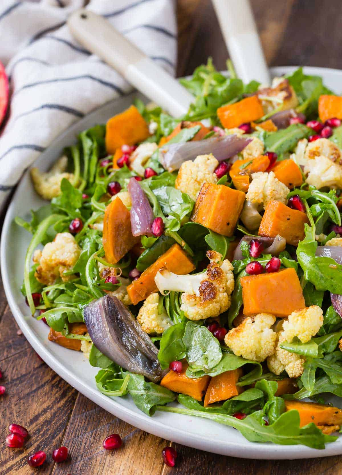 Salad with roasted cauliflower, pomegranate arils, and sweet potatoes.