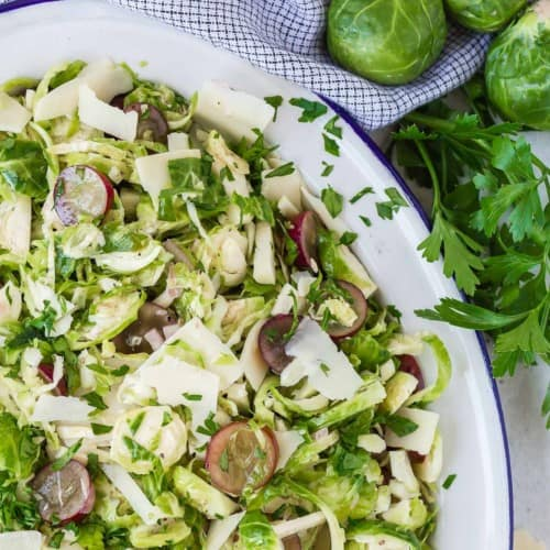 Close up of brussels sprouts salad with grapes.