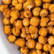 "Chickpeas in a bowl, text overlay reads ""air fryer crispy chickpeas, rachelcooks.com"""