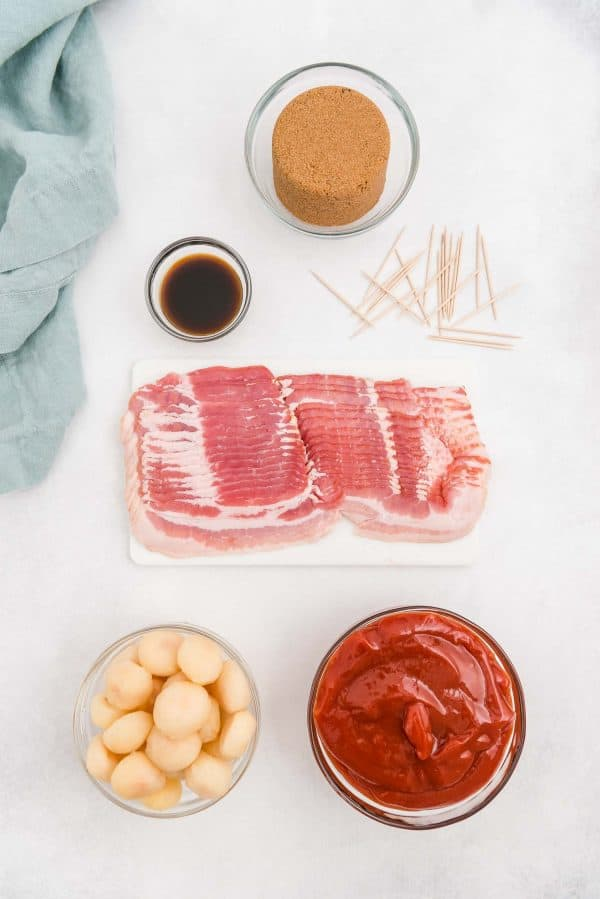 Overhead view of ingredients: bacon, water chestnuts, ketchup, brown sugar, worchestshire.