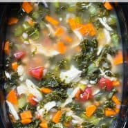 "Colorful soup in a black slow cooker, text overlay reads ""crockpot chicken and kale soup, rachelcooks.com"""