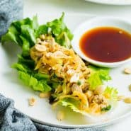Lettuce wrap on a plate with dipping sauce.