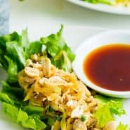 """Lettuce on a plate with chicken and other fillings, text overlay reads """"the best chicken lettuce wraps, rachelcooks.com"""""""