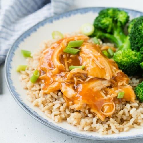 Honey and sriracha glazed shredded chicken over rice, served with steamed broccoli.