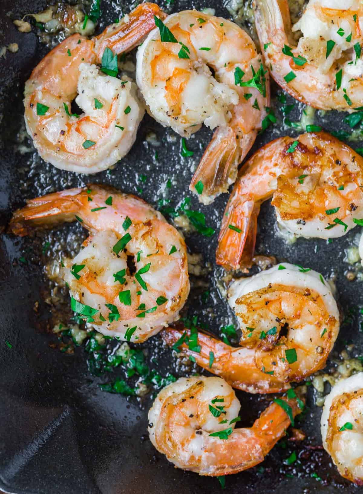 Shrimp with butter, garlic, and lemon. Garnished with parsley.