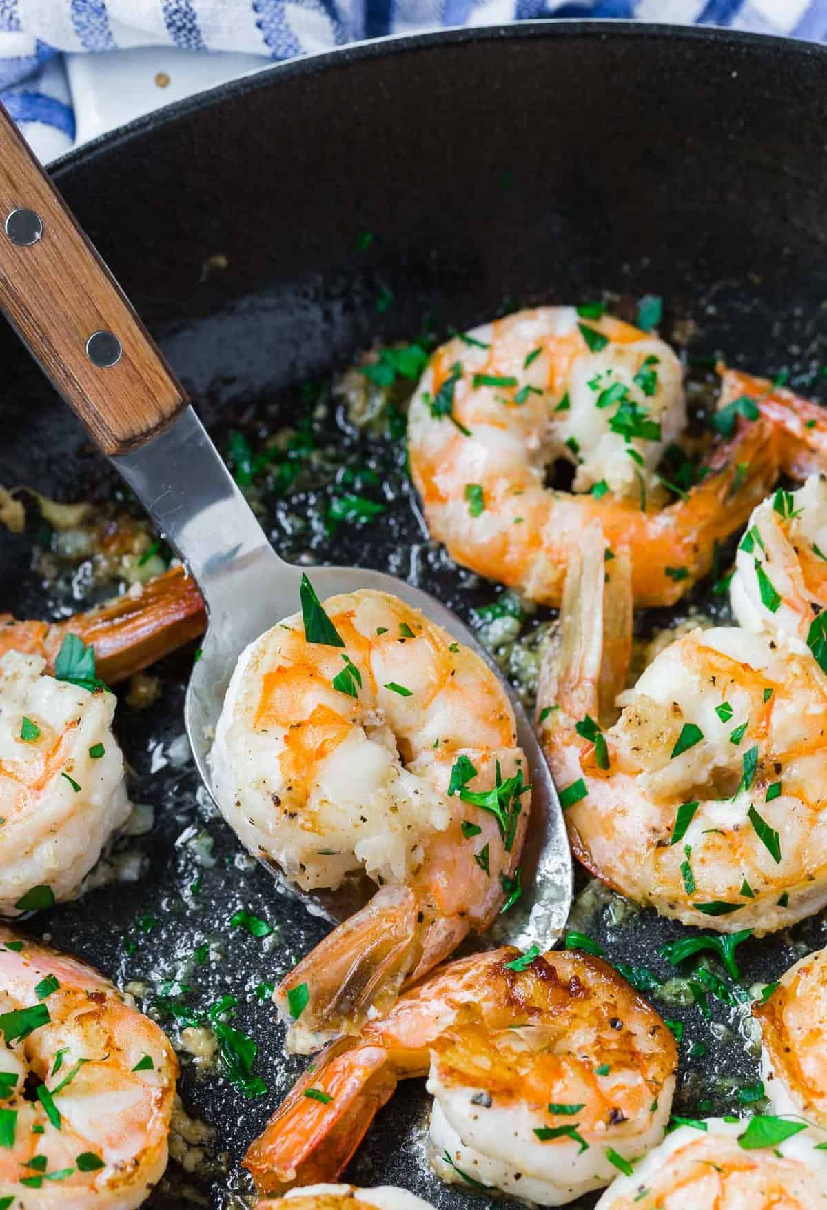 Shrimp on a serving spoon.