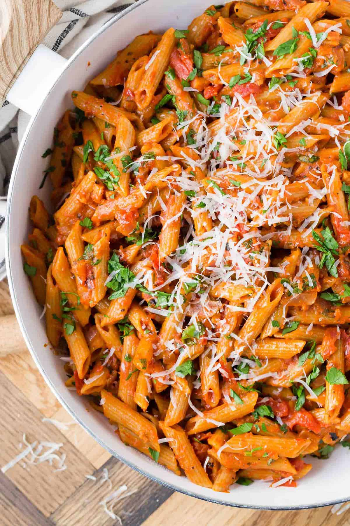 Close up of whole wheat penne in a tomato sauce.