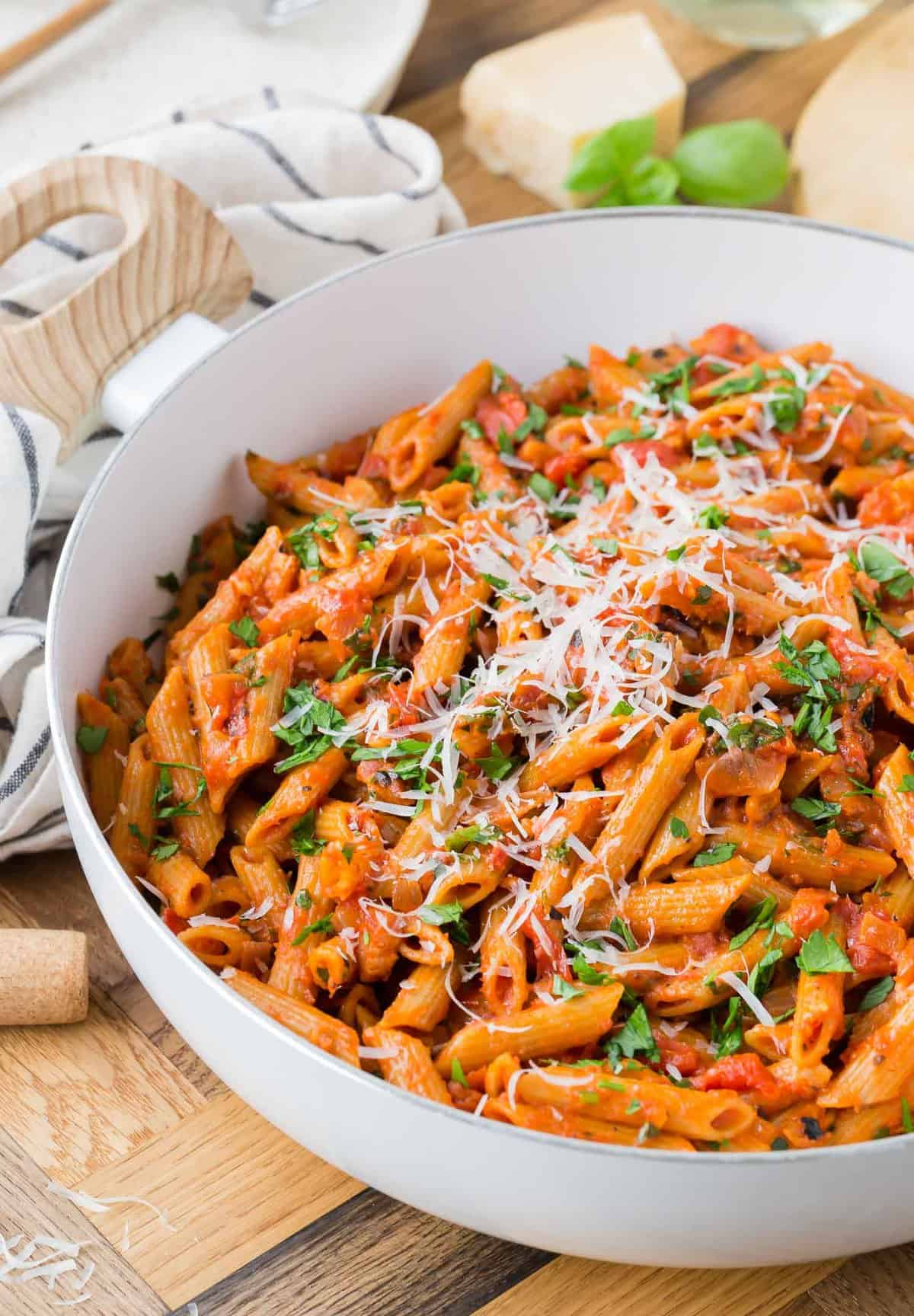 Pasta with tomato sauce in a white pan.