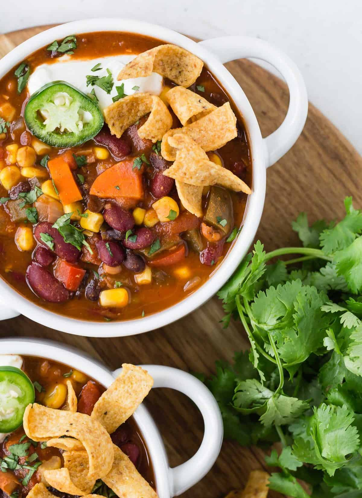Vegetarian chili with fritos, jalapeno, sour cream, and cilantro.