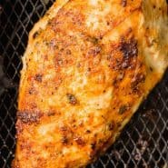 """Cooked chicken, text overlay reads """"air fryer chicken breasts, rachelcooks.com"""""""