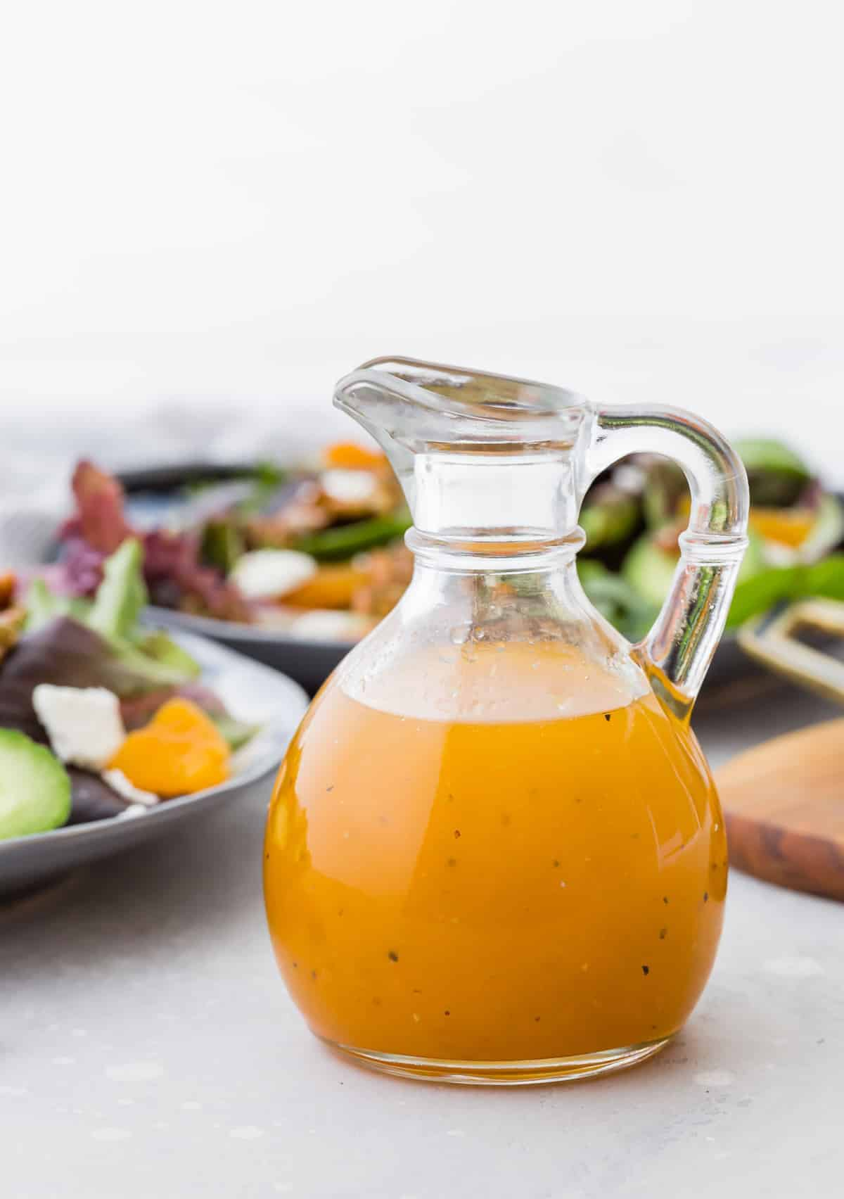 Apricot vinaigrette in a small glass pitcher.