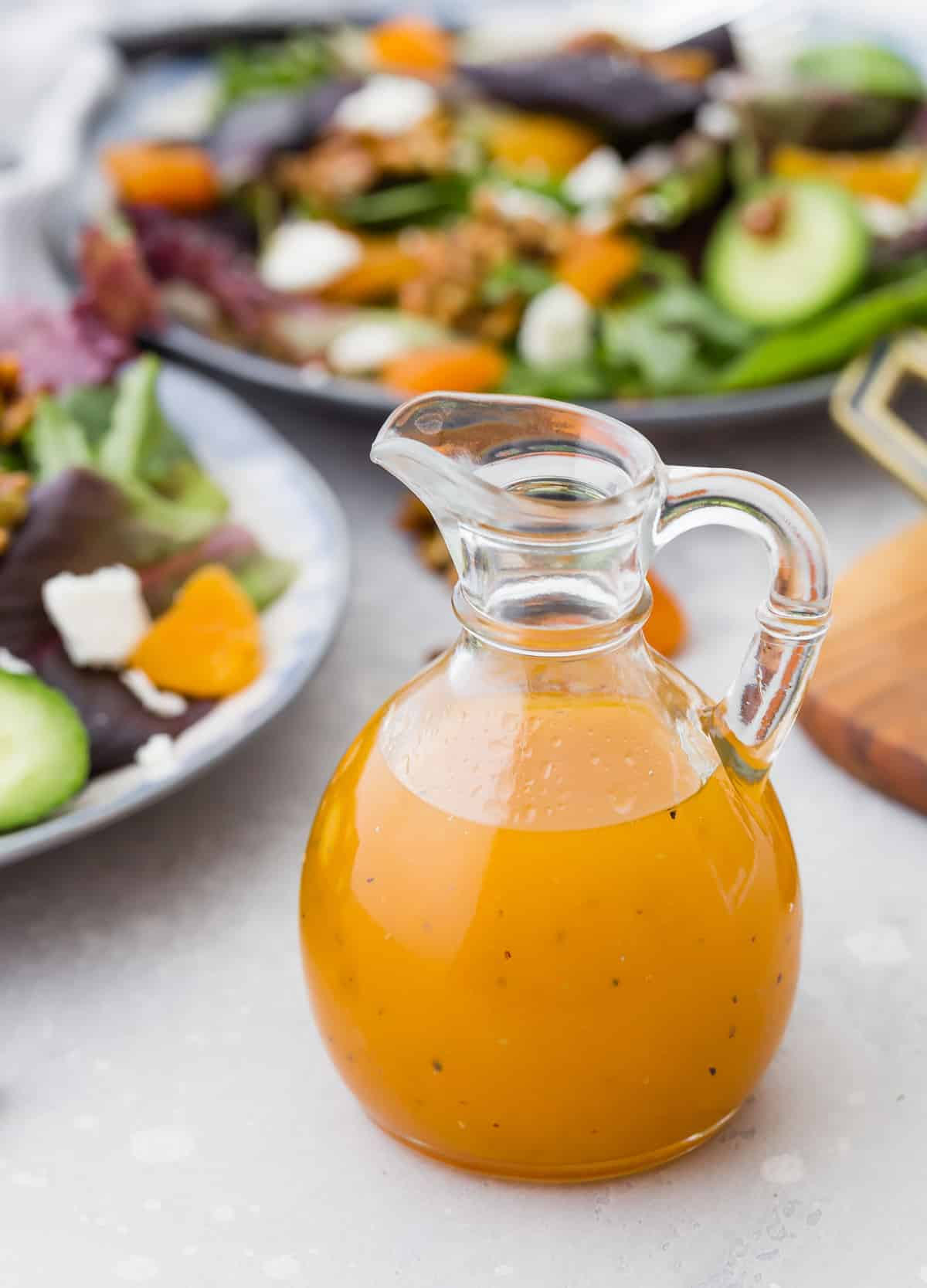 Apricot salad dressing in a small glass pitcher.