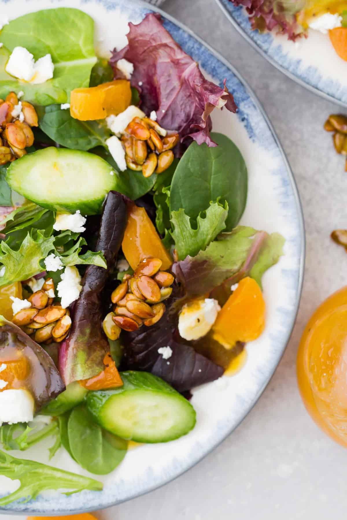 salad with dried apricots, cucumbers, pepitas.