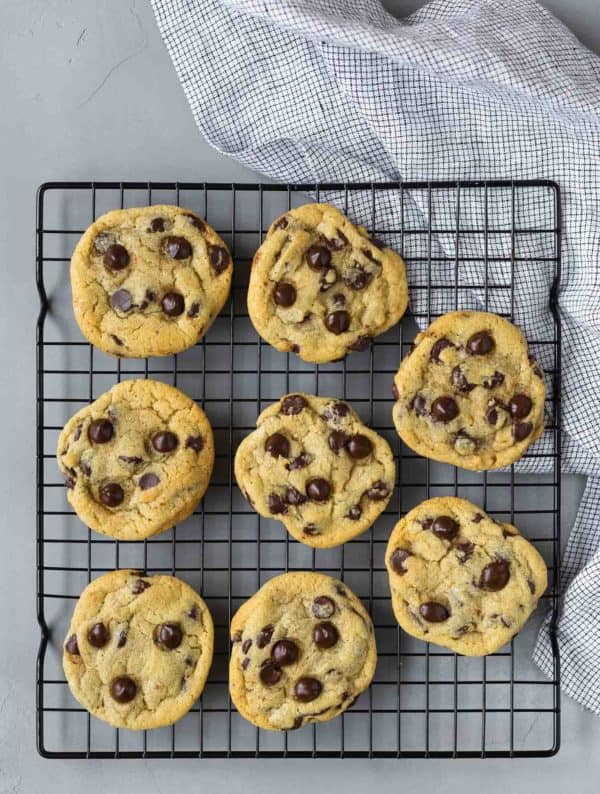 Overhead view of 8 chocolate chip cookies on a cooling rack.