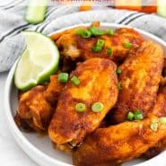 "Wings in a white dish, text overlay reads ""chili lime chicken wings"""