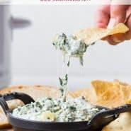"Spinach dip in a black dish, text overlay reads ""crockpot spinach artichoke dip, rachelcooks.com"""
