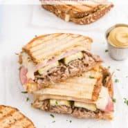 """Close up of cut Cuban sandwich, text overlay reads """"Cuban Sandwich, RachelCooks.com"""""""