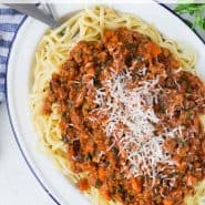 "Large platter of pasta, text overlay reads ""easy turkey bolognese sauce, rachelcooks.com"""