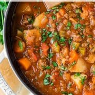 """Overhead view of soup, text overlay reads """"hearty and easy to make hamburger soup, rachelcooks.com"""""""