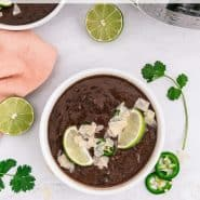"""Overhead view of a bowl of soup, text overlay reads """"instant pot black bean soup"""""""