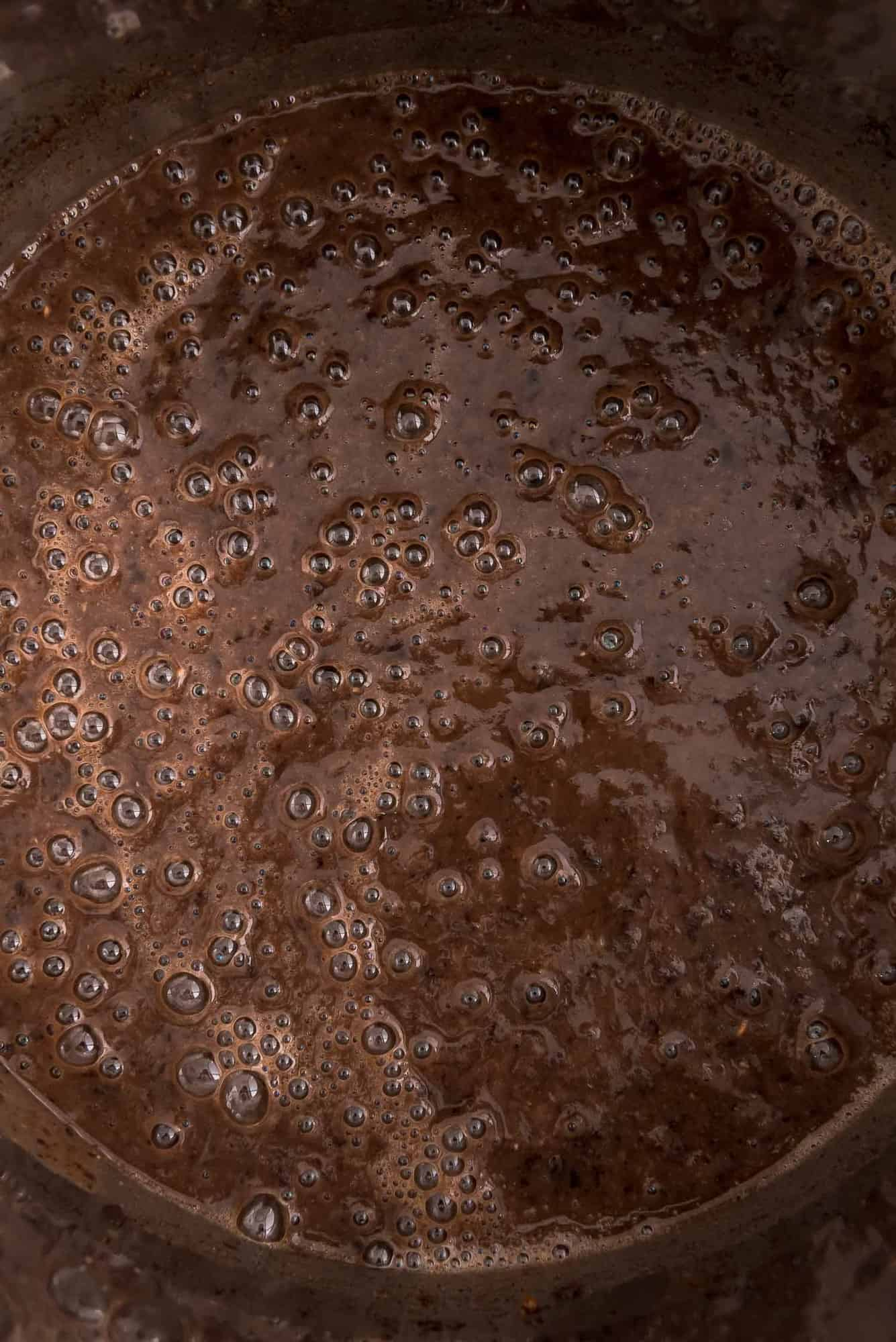 Close up view of black bean soup in an Instant Pot.