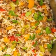 "Close up of sausage and rice, text overlay reads ""one pan sausage, rice, and peppers, rachelcooks.com"""