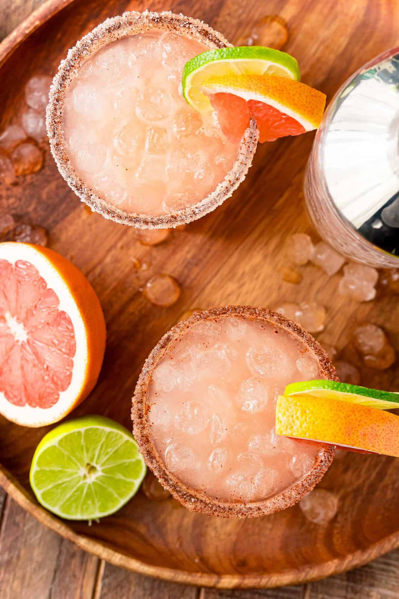 Overhead view of two paloma cocktails served on ice.