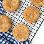 Overhead view of cinnamon cookies on a cooling rack.