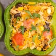 """A stuffed pepper in a pan, text overlay reads """"southwestern stuffed bell peppers with quinoa, rachelcooks.com"""""""