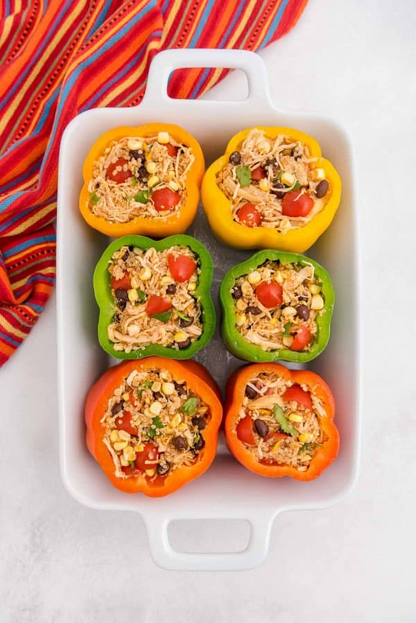 Filled peppers before being baked.